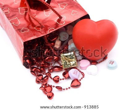 isolated gift bag and presents  with xoxo and hearts,shallow dof,close-up - stock photo