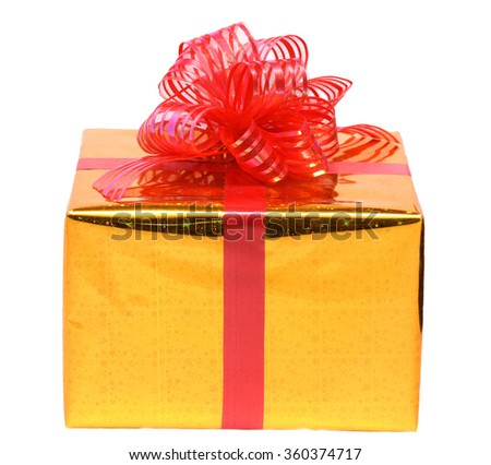isolated gift box in the gold package with red bow on white background. - stock photo