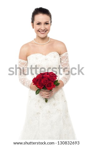 Isolated glamorous studio shot of a bride with a rose bouquet. - stock photo