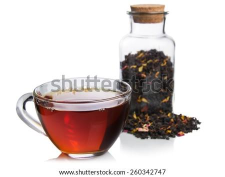 Isolated glass cup tea with tea jar - stock photo