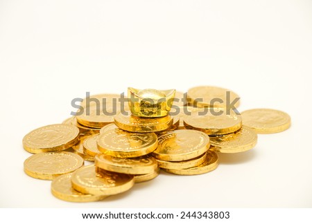 Isolated gold coin and bar, symbol of wealth and prosperity for business or financial background - stock photo