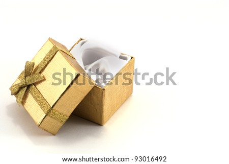Isolated gold present on white background - stock photo