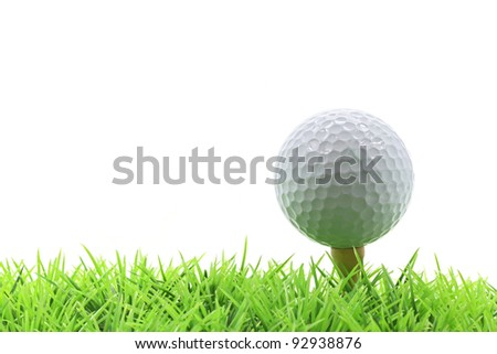 isolated golf ball on pin over green grass with white background - stock photo