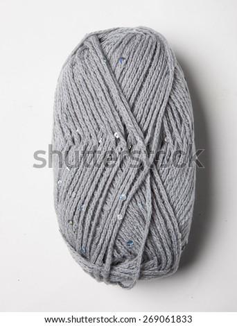Isolated gray knitting wool - stock photo