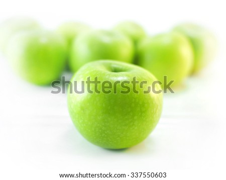 Isolated green apples - stock photo