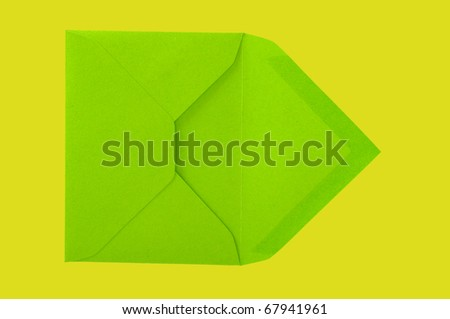 Isolated green envelope on the yellow surface with paths. - stock photo