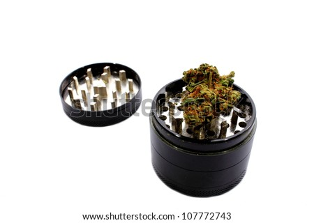 Isolated grinder used to grind marijuana into smaller pieces. - stock photo