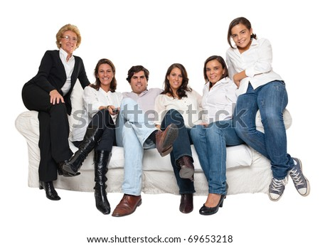 Isolated group of family members sitting on a sofa watching TV - stock photo