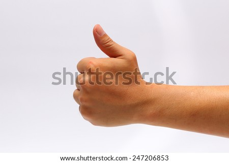 Isolated hand giving thumbs up on over White background - stock photo