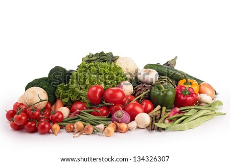 isolated heap of vegetables - stock photo