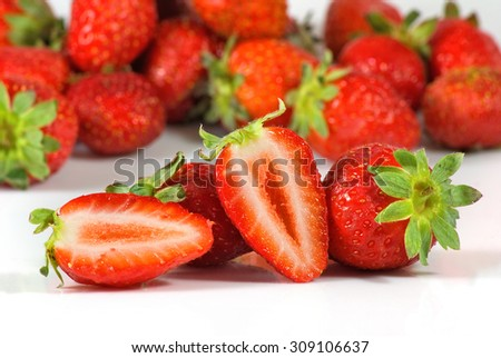 Isolated image of a ripe strawberry  closeup - stock photo