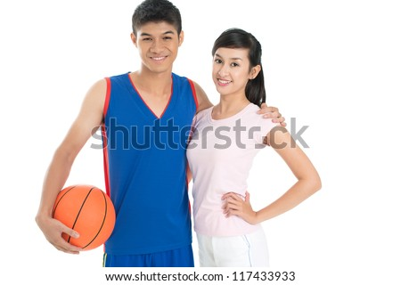 Isolated image of cheerful basketball players posing for the camera - stock photo