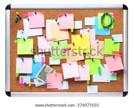 Isolated image of colorful sticky notes on cork bulletin board - stock photo