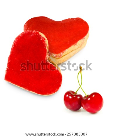 Isolated image of cookies and cherry - stock photo