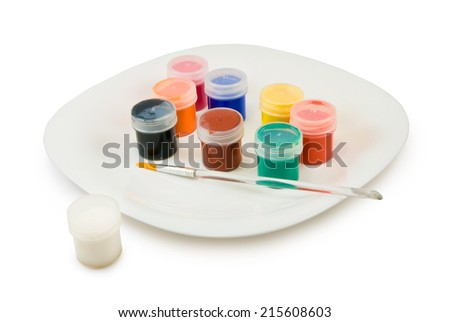 Isolated image of different paints and brush on a white plate - stock photo