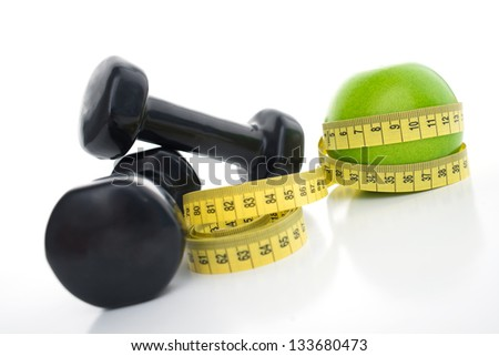 Isolated image of dumbbells and measurement - stock photo