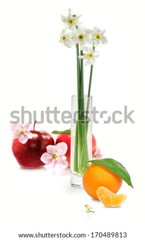 Isolated image of flowers in a vase, apple and orange on a white background - stock photo