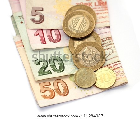 isolated image of Turkish lira coins and folded notes - stock photo