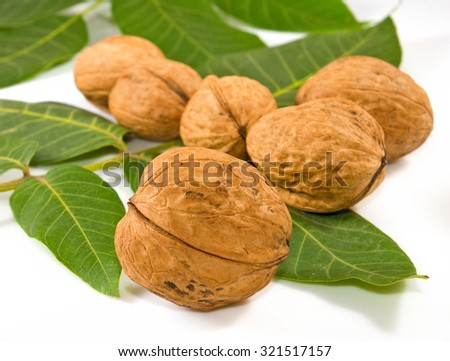 Isolated image of walnuts on a white background closeup - stock photo