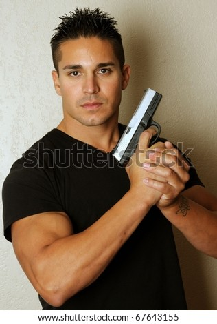 Isolated image of young male with firearm - stock photo