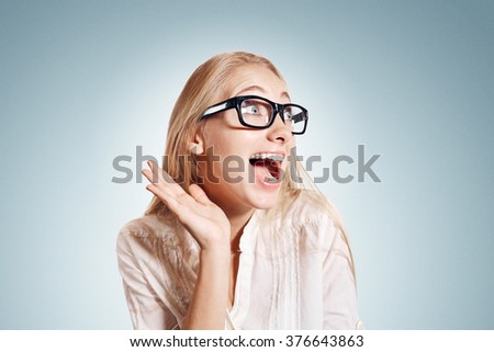 Isolated joyful carefree happy portrait of a young woman isolated on background waist up. Beautiful caucasian female model in white shirt and glasses - stock photo