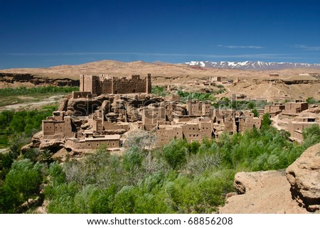Isolated Kasbah near Ouarzazate, Atlas Mountains in Morocco - stock photo