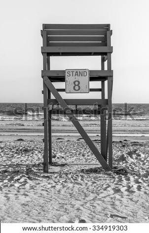 Isolated lifeguard tower. The number eight. Beach lifeguard station. Beach and ocean. Ocean background. Sea background. Waves background. Beach life. Minimal design. Abstract art. Black and white. BW. - stock photo