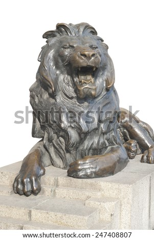 Isolated lion sitting on stone stage - stock photo