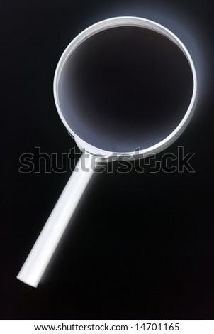 Isolated loupe on the white background - stock photo