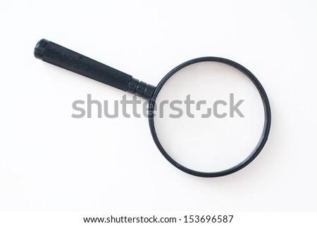 isolated magnifying glass on black background - symbol  - stock photo