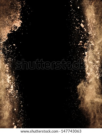 Isolated make-up powder on black background - stock photo