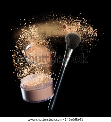 Isolated make-up powder with brush on black background - stock photo