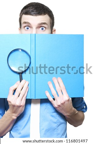 Isolated Male Business Person Holding Magnifying Glass And Textbook In A Book Review Concept On White Background - stock photo