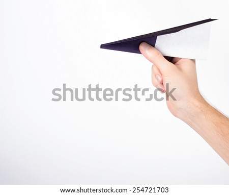 isolated male hand holding paper airplane - stock photo