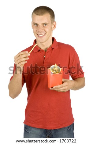 isolated man eats French fries - stock photo