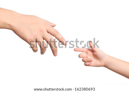 isolated men and children hands reach toward each other - stock photo