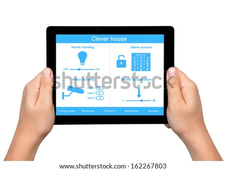 isolated men hands hold a tablet touch computer with system clever house on the screen - stock photo