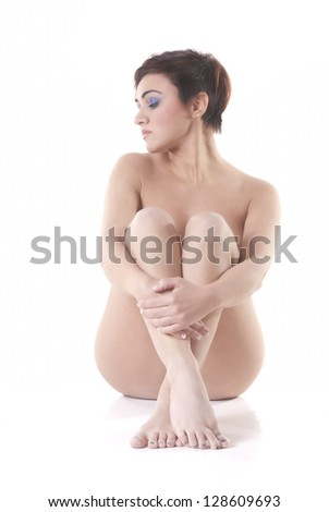 Isolated naked woman sit on white background - stock photo