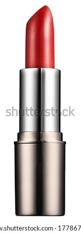 Isolated new red lipstick with the cap removed in a silver container on a white background in a beauty concept - stock photo