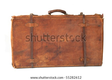 Isolated old and weathered leather suitcase standing - stock photo
