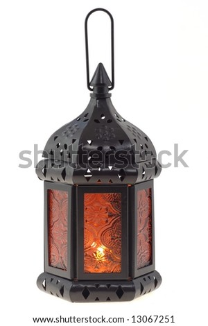 Isolated old-fashioned lamp with candle inside - stock photo
