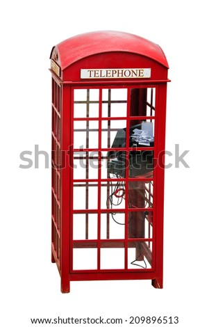 Isolated Old-fashioned traditional red public telephone booth - stock photo