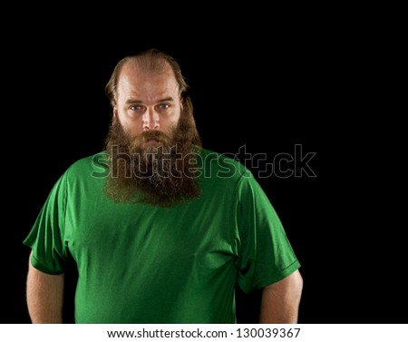 isolated on a black background a balding man with a big beard. - stock photo