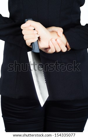 Isolated on the back of business woman with a knife - stock photo