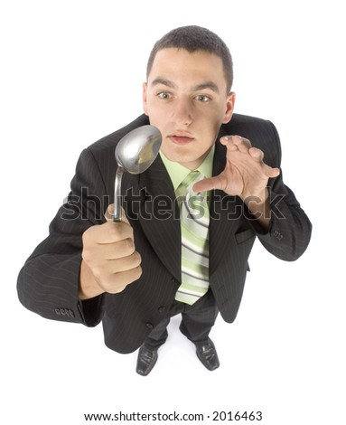 isolated on white businessman bending spoon by mind force - stock photo