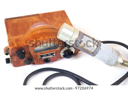 Isolated on white old soviet geiger counter for measurement of radiation. - stock photo