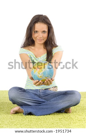 isolated on white woman sitting on the green carpet - giving globe - stock photo