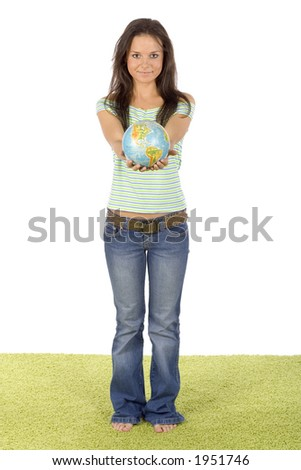 isolated on white woman standing on the green carpet - giving globe - stock photo