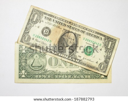 Isolated one dollar banknotes on a white background, featuring a portrait of President George Washington - stock photo