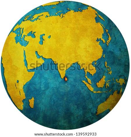 isolated over white territory of sri lanka with flag on globe map - stock photo